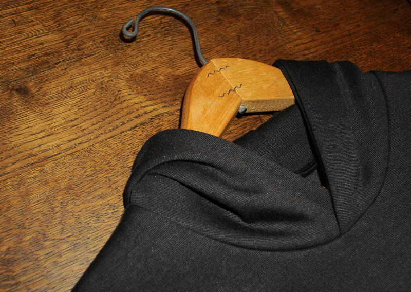 grey hoodie neck opening on wood table