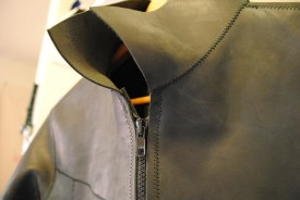 collar of a black leather jacket with zippered front