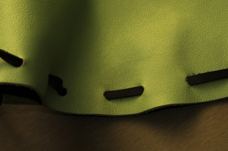 green leather backpack detail photo