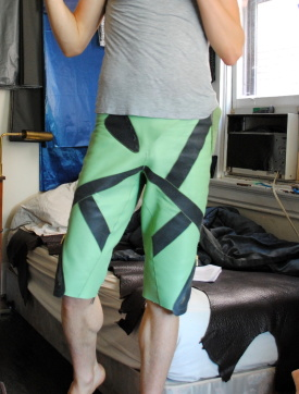 leather bicycle shorts, green and black